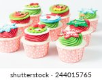 christmas decorated cupcakes | Shutterstock . vector #244015765