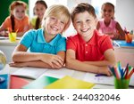 two cheerful schoolboys looking ... | Shutterstock . vector #244032046