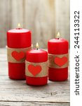red burning  candles over wood... | Shutterstock . vector #244113322