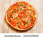 pizza on the wood background   Shutterstock . vector #244154965