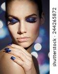 model wearing blue glittery... | Shutterstock . vector #244265872