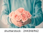 Hands Holding Bouquet Of...