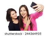 two girls friends taking selfie ... | Shutterstock . vector #244364935