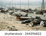 Demolished vehicles line Highway 80 the