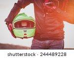 Biker Man Helmet And Mobile...