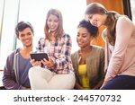 happy young student holding...   Shutterstock . vector #244570732
