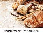 freshly baked bread in rustic... | Shutterstock . vector #244583776
