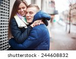 cheerful young couple on a city ... | Shutterstock . vector #244608832