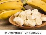 a banch of bananas and a sliced ...