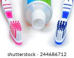 Pink  Blue Toothbrushes And...
