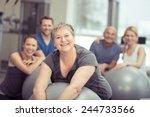 Smiling Senior Woman Enjoying...