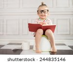 Baby Girl On Potty With Notebook