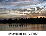 people rowing on green lake at sunrise in seattle washington - stock photo