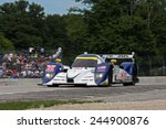 Elkhart Lake Wisconsin, USA - August 18, 2012: Road America Road Race, ALMS / IMSA prototype sports car motor race. American Le Mans Series. Michael Marsal, Eric Lux Canada, Tony Burgess, Lola B11/66  - stock photo