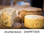Wheels Of Cheese Seasoned With...