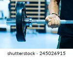 man with training equipment on... | Shutterstock . vector #245026915