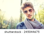 young handsome man in nature... | Shutterstock . vector #245044675