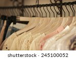 Stock photo fashionable clothes on pegs in a cloak room 245100052