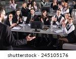 rear view of male speaker on... | Shutterstock . vector #245105176