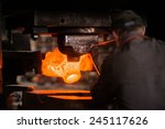 hot iron in smeltery held by a... | Shutterstock . vector #245117626