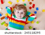 little blond child playing with ... | Shutterstock . vector #245118295