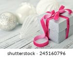 gift box with pink ribbon and... | Shutterstock . vector #245160796