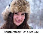 young woman in wintertime... | Shutterstock . vector #245225332