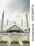 Small photo of ISLAMABAD, PAKISTAN - MARCH 14, 2013: View of Faisal Mosque in Islamabad on a cloudy day.
