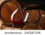 pouring red wine from bottle... | Shutterstock . vector #245287198