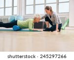Senior Woman Exercising With A...
