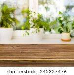 wooden table on defocused... | Shutterstock . vector #245327476