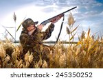Rifle Hunter Silhouetted In...