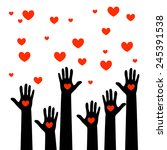 the colorful raised hands with... | Shutterstock .eps vector #245391538
