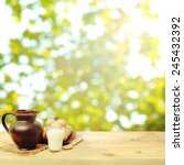 table with a jug  milk and eggs ... | Shutterstock . vector #245432392