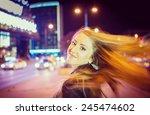 Girl Walking On The Night City...