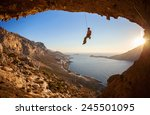 rock climber hanging on rope... | Shutterstock . vector #245501095