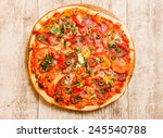 pizza on the wood background   Shutterstock . vector #245540788