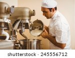 baker pouring flour into large... | Shutterstock . vector #245556712