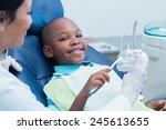 Dentist Teaching Happy Boy How...