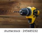 Electric Drill On A Wooden...