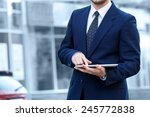 businessman holding a digital... | Shutterstock . vector #245772838