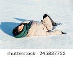 beautiful brunette girl lying... | Shutterstock . vector #245837722