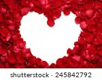 Stock photo heart of red rose petals isolated on white background 245842792