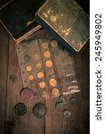 vintage books and coins on old... | Shutterstock . vector #245949802