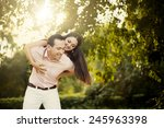 lovely young couple in love... | Shutterstock . vector #245963398