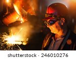 Foundry Worker Looking At...