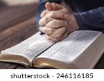 Small photo of Man reading from the holy bible, close up