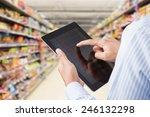 businessman checking inventory... | Shutterstock . vector #246132298