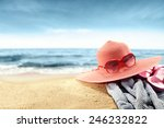 glasses sun hat and towel  | Shutterstock . vector #246232822