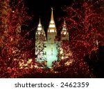 night time around a church decorated with christmas lights - stock photo